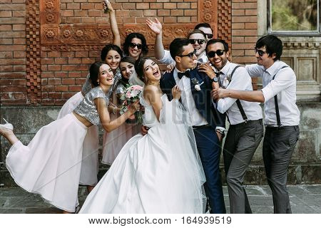 Emotional Photo Of The Beautiful Couple With The Friends
