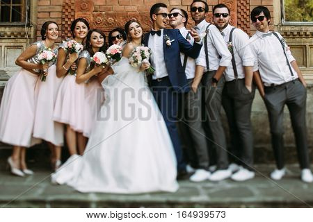 Cheerful Couple With The Friends In The Wedding Day