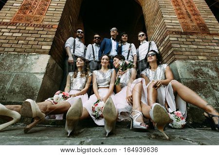 Groom with his friends and bridesmaids on the street