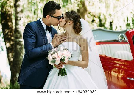 Tender Kiss Of The Two In Their Wedding Day