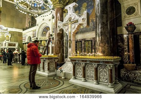 Kronstadt .Russia. January 6 2017. The parishioners of the Kronstadt Naval Cathedral in the Christmas winter evening . Saint-Petersburg.