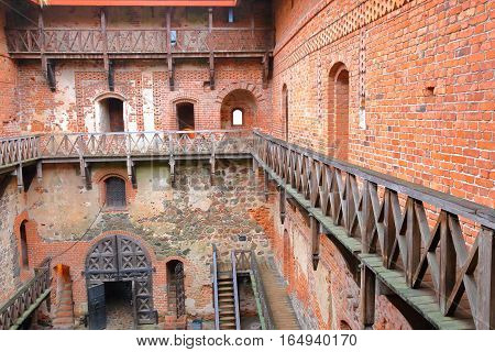 TRAKAI, LITHUANIA - JANUARY 1, 2017: Trakai castle built on an island of Lake Galve near Vilnius - The interior courtyard and wooden walkays