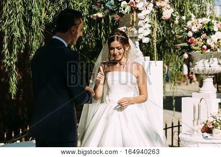 Happy Groom And Bride On The Wedding Ceremony