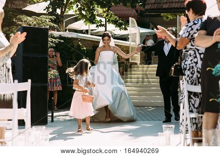 Gorgeous bride is walking on the wedding ceremony