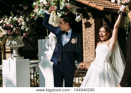 Just married couple with a bouquet on the ceremony
