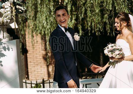 Happy Groom Next To The Bride On The Wedding Ceremony