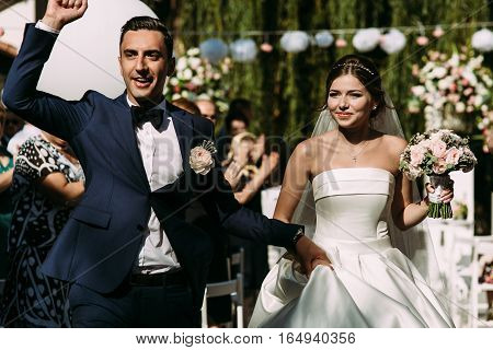 Gorgeous bride and handsome groom on the street