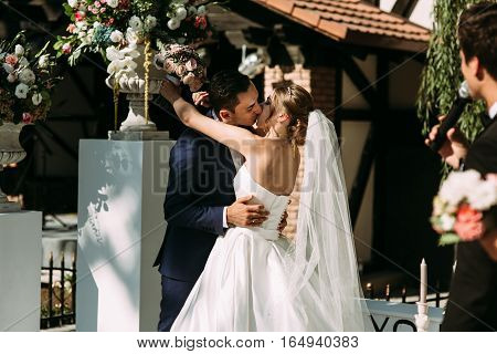 Romantic Kiss On The Beautiful Wedding Ceremony