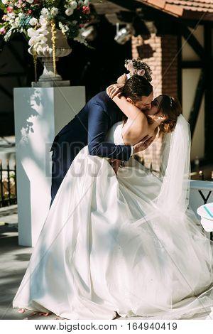 Romantic kiss during amazing wedding ceremony on the street