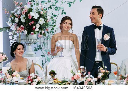 Lovely married couple is listening a toast