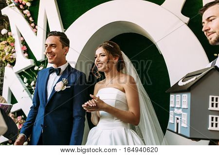 Joyful married couple and beautiful background behind