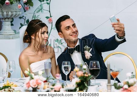 Married Couple Is Taking A Selfie On The Wedding