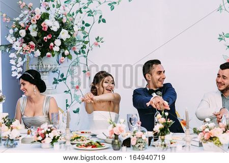 Fun of the married couple on the wedding celebration