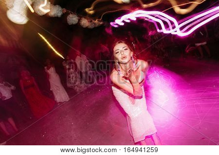 Bride sends air kiss on the dance floor