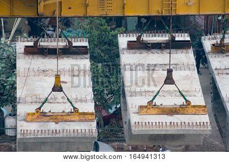 Delhi, India - 8th Jan 2017: Prefabricated concrete blocks used for the construction of the overhead delhi metro.