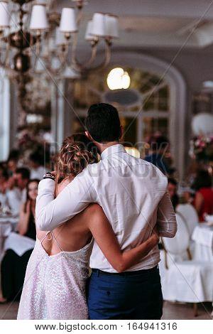 Romantic couple in the huge luxury restaurant