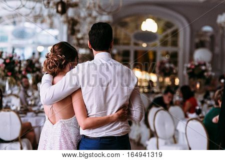 Romantic Embracement Of The Just Married Couple In The Restaurant