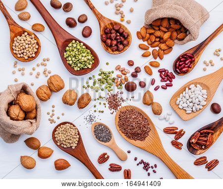 Various Legumes And Different Kinds Of Nuts In Spoons. Walnuts Kernels ,hazelnuts, Almond ,brown Pin
