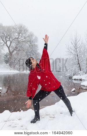an attractive woman practicing yoga during a rare snowstorm near Sedona arizona