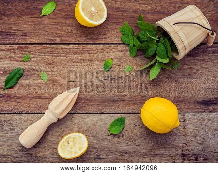 Fresh Lemon And Wooden Juicer For Summer Juice And Cocktail. Fresh Lemon Sliced And Peppermint Leave