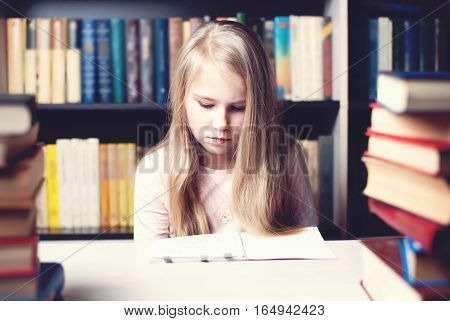 Little Student Girl Studying And Reading Book At School