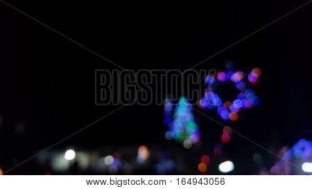 loopingof defocused flowing light dots on the background
