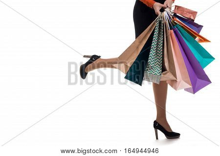 Lower Close-up, Girl Runs Holding Shopping Paper Bags And Packages