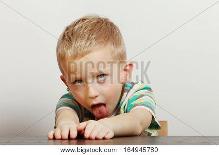 Kid Making Funny Faces Being Bored