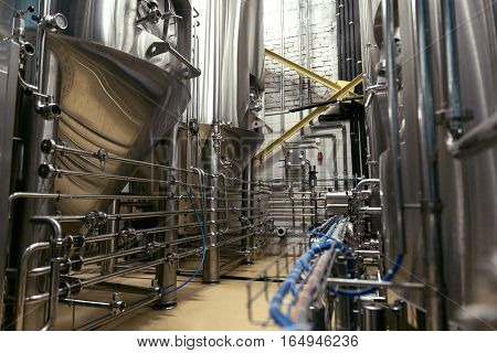 Best equipment. Interior of big professional brewery being well equipped.
