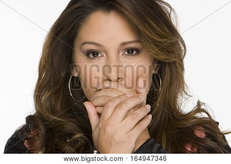 Young happy Hispanic woman isolated on white.