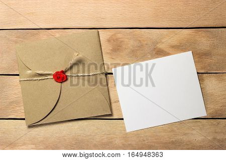 The envelope and a piece of text on a wood background
