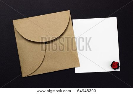 The envelope and a piece of text on a black background