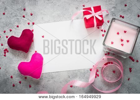 Valentines day background. Postcard confession of love. Two hearts ribbon and gift.
