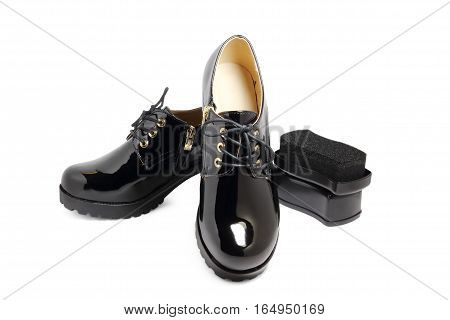 black lacquered shoes on a white background
