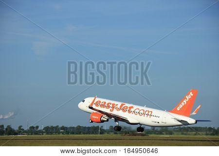 Amsterdam the Netherlands - June 9th 2016: G-EZWY easyJet Airbus A320-214(WL) takeoff from Polderbaan runway destination Basel Switzerland