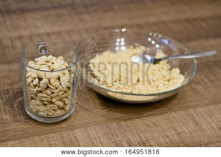 whole or crushed peanuts in a glass bowl on the kitchen table