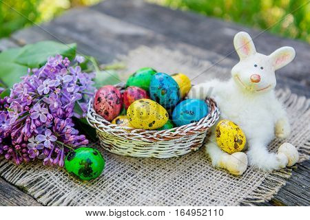 painted Easter eggs with bunny. Easter decoration with rabbit and eggs
