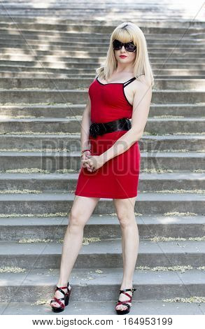 the woman in a red dress on stone steps a subject beautiful women