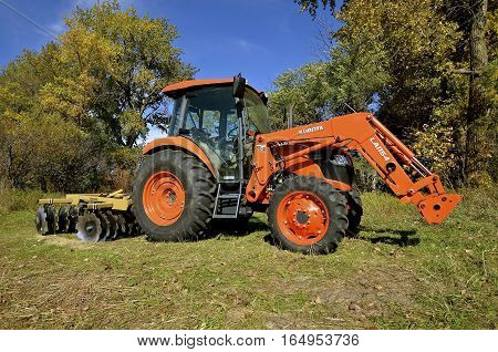 LEONARD, NORTH DAKOTA, Sept 29, 2106:  The orange tractor is a product of Kubota Corporation, a tractor and heavy equipment manufacturer based in Osaka, Japan., established in 1890.