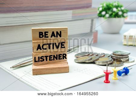 Text message be an active listener on wooden with book back, Finance concept