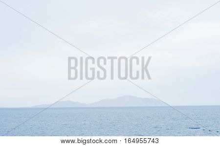 Beach. Calm Sea Ocean And Blue Sky Background. Ocean nature tranquility. Red sea