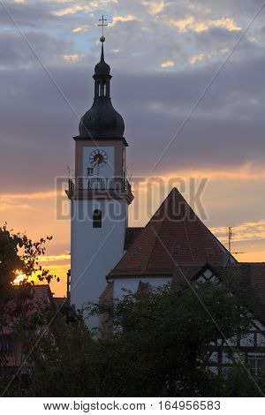 Catholic parish church St. Johann Baptist in Hilpoltstein Germany in evening light.