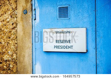 Universite Reserve President translating as Reserved for the Dean President as seen on the parking sign at the university campus parking