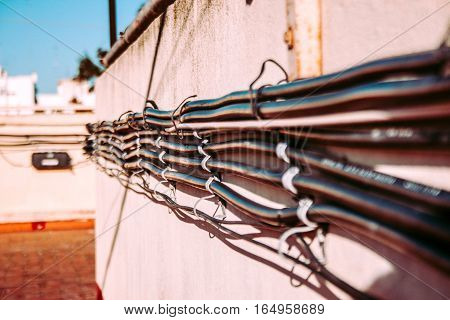 Various cables, communication wires on the wall of the building