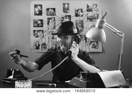 Retro detective agent in office with important documents on office desk, 1950s style.