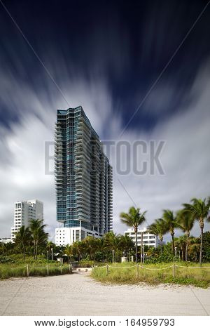 MIAMI BEACH - JANUARY 12: Stock photo of the Setai Hotel and residences located at 2001 Collins Avenue shot with a long 30 second exposure to blur sky and trees January 12, 2017 in Miami Beach FL, USa