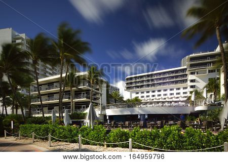 MIAMI BEACH - JANUARY 12: Stock image of the Ritz Carlton Hotel located at 1 Lincoln Road shot with a long 30 exposure to blur traffic and sky January 12, 2017 in Miami Beach FL, USA