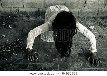 Ghost woman crawling on the floor  in haunted house