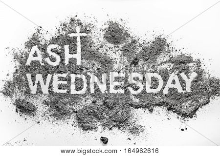Ash wednesday word written in ash and christian cross symbol as a religion concept