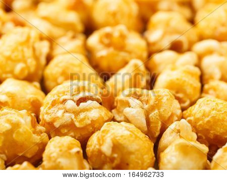 Close up of fresh popcorn covered with caramel.